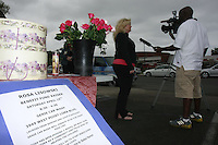 San Diego, CA, Saturday, April 20 2008:  Heather Peterson speaks to a TV news crew during a charity drive for the children of Rosa Lisowski at Genie Car Wash at 3949 W Point Loma Blvd.   The business owners donated $5 from every car wash during the event.  Lisowski who was embroiled in a bitter divorce with her husband disappeared after dropping one of her children off at the Barnard Elementary school on the morning of Monday March 24 2008.