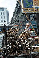Constructing scaffolding out of bamboo poles. Kowloon, Hong Kong, China