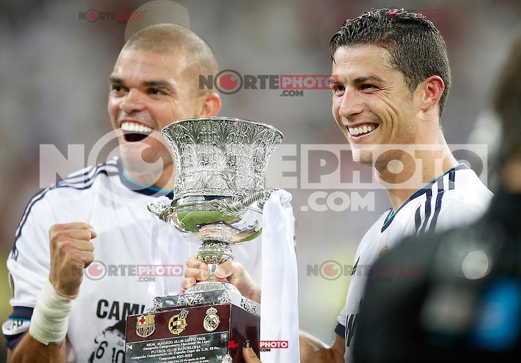 Real Madrid's Pepe and Cristiano Ronaldo celebrate with trophy after Super Cup match. August 29, 2012. (ALTERPHOTOS/Alvaro Hernandez). /NortePhoto.com<br /> <br /> **CREDITO*OBLIGATORIO** <br /> *No*Venta*A*Terceros*<br /> *No*Sale*So*third*<br /> *** No*Se*Permite*Hacer*Archivo**<br /> *No*Sale*So*third*