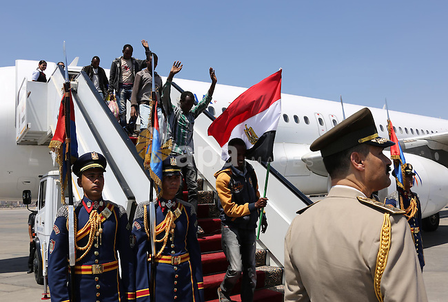 A handout photo made available by the Egyptian Presidency shows Ethiopian nationals, who were kidnapped in Libya and freed, holding an Egyptian national flag as they disembark a plane at airport in Cairo, 07 May 2015. According to reports, Egyptian President Abdel Fattah al-Sisi received 27 Ethiopians upon arrival in Egypt after they were freed from their kidnappers in Libya. The Islamic State militia in Libya released on 20 April a video showing the execution of two groups of Ethiopian Christians in Libya. The militia previously executed a group of Egyptian Coptic Christians on the Libyan beaches. The group has made inroads in the lawless state, where the central government has lost control over most of the country. Photo by Egyptian Presidency