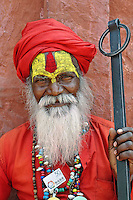 Colorfully decorated street begger, Agra, India.