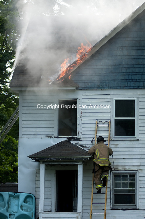 TORRINGTON, CT - 20 JUNE 2014 -- Flames curl from the eves of 30 South Chapel St. in Torrington Friday evening. The house caught fire about 6:35 p.m. Friday. Alec Johnson/ Republican-American