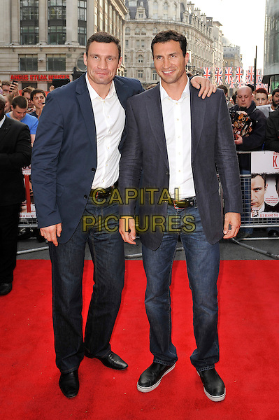 Vitali and Wladimir Klitschko.The UK Premiere of 'Klitschko', Empire Cinema, Leicester Square, London, England. .21st May 2012.full length jeans denim blue suit jacket white shirt.CAP/MAR.© Martin Harris/Capital Pictures.