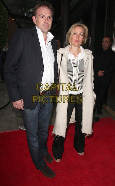 GILLIAN ANDERSON & MARK GRIFFITHS .Press Night for Northern Ballet's 'Cleopatra' at Sadlers Wells, London, England, UK, May 17th 2011..full length black coat  suit jacket jeans trousers cream beige  couple  striped top .CAP/ROS.©Steve Ross/Capital Pictures