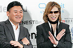 (L to R) Hiroshi Mikitani Chairman and CEO of Rakuten Inc. and rock star Yoshiki of X JAPAN, pose for cameras during the second day of the New Economy Summit (NEST 2017) on April 7, 2017, Tokyo, Japan. The annual summit brings together global entrepreneurs and innovators for a two-day event in Tokyo. (Photo by Rodrigo Reyes Marin/AFLO)