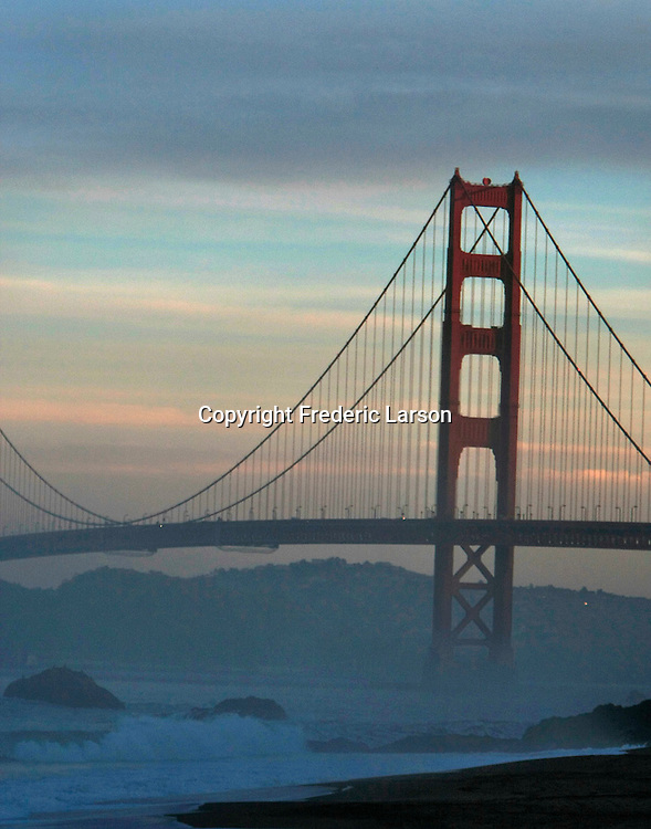 The Golden Gate Bridge at the morning twilight hours as seen from Baker's Beach in San Francisco, California.