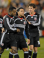 DC United midfielder Christian Gomez (10) celebrates after scoring a penalty kick with team mates Luciano Emilio (11) and Devon Mactavish (18) right, in the home game of  the second leg of the Concacaf Champions' Cup  match between DC. United and CD.Olimpia from Honduras, DC United defeated CD. Olimpia 3-2  to advance to the semi finals of this year's Champions' Cup and play CD Guadalajara from Mexico in a series beginning in mid-March,  March 1, 2007, at RFK Stadium in Washington, DC.
