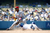 Alex Gonzalez of the Cincinnati Reds waits for the ball as Rafael Furcal of the Los Angeles Dodgers slides into second base during a game in the 2007 MLB season game at Dodger Stadium in Los Angeles, California. (Larry Goren/Four Seam Images)