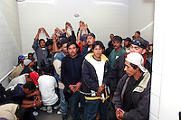 Undocumented Immigrants waiting to be processed at the Sheriff's 4th Street Jail in Phoenix, AZ..Photo by AJ Alexander