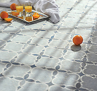 Aiden&reg;, a natural stone mosaic shown in polished and honed Celeste with polished Blue Macauba and Thassos is part of New Ravenna's Studio Line. All mosaics in this collection are ready to ship within 48 hours.<br />