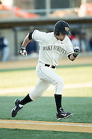 Logan Harvey (15) of the Wake Forest Demon Deacons hustles down the first base line against the Richmond Spiders at David F. Couch Ballpark on March 6, 2016 in Winston-Salem, North Carolina.  The Demon Deacons defeated the Spiders 17-4.  (Brian Westerholt/Four Seam Images)