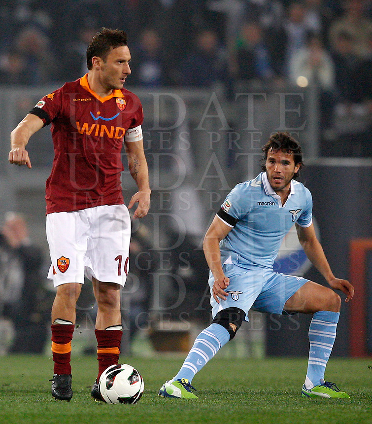 Calcio, Serie A: Roma vs Lazio. Roma, stadio Olimpico, 8 aprile 2013..AS Roma forward Francesco Totti, left, is challenged by Lazio midfielder Alvaro Gonzalez, of Uruguay, during the Italian Serie A football match between AS Roma and Lazio at Rome's Olympic stadium, 8 April 2013..UPDATE IMAGES PRESS/Riccardo De Luca