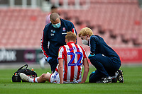 27th June 2020; Bet365 Stadium, Stoke, Staffordshire, England; English Championship Football, Stoke City versus Middlesbrough; Sam Clucas of Stoke City receives treatement from Stoke medical staff in masks