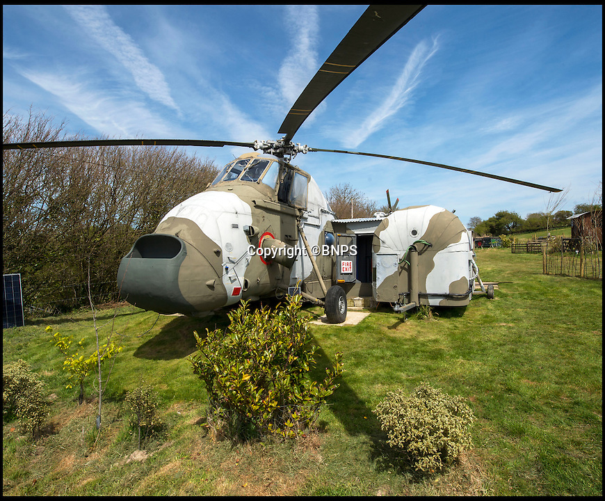BNPS.co.uk (01202 558833)<br /> Pic: PhilYeomans/BNPS<br /> <br /> Ultimate Heli-pad for a holiday - Campsite owner Stewart Dungey is hoping his new venture takes off - after turning a decommissioned Royal Navy helicopter into a unique holiday let.<br /> <br /> Stewart has spent &pound;30,000 buying, transporting and converting a Cold War Westland Wessex chopper on his farm on the Isle of Wight<br /> <br /> With an Airstream caravan kitchen annex one side and a bedroom pod on the other the chopper now provides luxury accomodation for adventurous families.