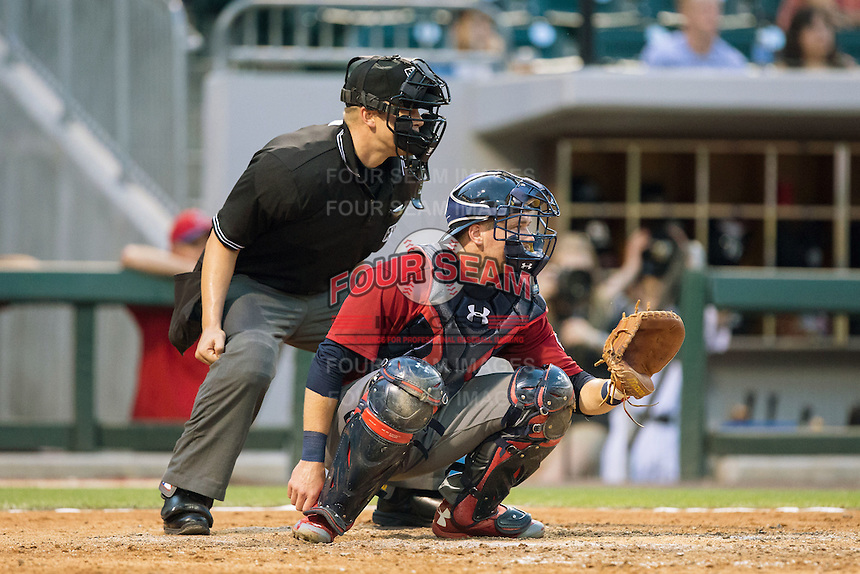Lehigh Valley Iron Pigs catcher Andrew Knapp (15) sets a target as home plate umpire Chris Segal looks on during the game against the Charlotte Knights at BB&T BallPark on June 3, 2016 in Charlotte, North Carolina.  The Iron Pigs defeated the Knights 6-4.  (Brian Westerholt/Four Seam Images)