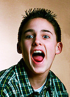 ..Excited teen boy shouts. MR