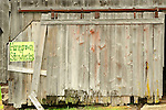 Old barn door with strawberry sign