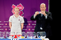 30 MAY 2012 - LONDON, GBR - IHF First Vice President Miguel Roca (right)  announces the group for current men's Olympic champions France during the London 2012 Olympic Games Handball Draw at the National Sports Centre in Crystal Palace, Great Britain watched by Great Britain women's captain Lynn McCafferty .(PHOTO (C) 2012 NIGEL FARROW)