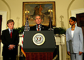 Washington, D.C. - August 1, 2005 -- United States President George W. Bush announces the recess appointment of John Bolton to be the United States Ambassador to the United Nations in the Roosevelt Room of the White House on August 1, 2005. left to right: John Bolton, President Bush, Secretary of State Condoleezza Rice. <br /> Credit: Dennis Brack - Pool via CNP