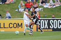Washington Freedom midfielder Homare Sawa (10) fights for possession of the ball against LA. Sol forward Matra (10).   The LA Sol defeated the Washington Freedom 1-0 at the Maryland Soccerplex, Sunday July 5, 2009.