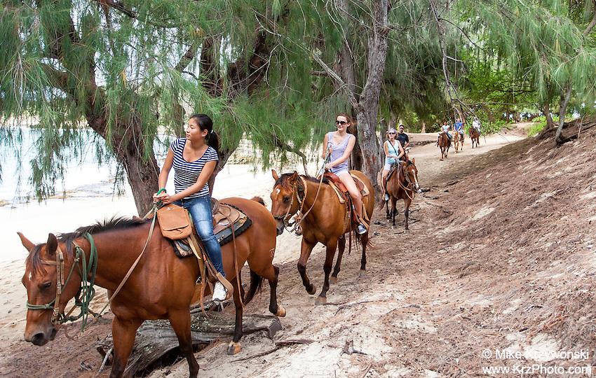 Horseback riding along Gillin's Beach, south shore of Kauai