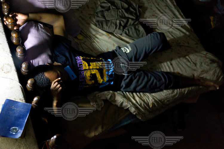 With his bible on the ledge beside him, Siyakudumisa Vapi, a licensed boxer hoping to make it as a professional, relaxes on his bed in a curtained-off space in the basement of the Hillbrow Boxing Club in Johannesburg. Vapi is training for a fight against the third-ranked fighter in the national featherweight division; if he wins it wil bring him closer to his objective of challenging for the national title, and being able to make a decent living from boxing. Vapi believes boxing pulled him away from the streets and bad company, and gave him discipline.<br />  Hillbrow, in downtown Johannesburg, is the city's most notorious neighbourhood. It is overcrowded, ridden with illegal squats and suffers from high levels of crime much of which is related the thriving illicit drug trade. Against this backdrop, George Khosi's story is not atypical. A childhood spent on the streets, where he survived by committing petty crime and hustling, led to imprisonment at the age of 16. Because he was big and looked older than his age this incarceration was in an adult institution. Here he began to fight since, as he says 'they wanted to make me a woman and I didn't want to be a woman.' When he got out, he took up boxing in earnest.&nbsp;His prospects as a professional boxer looked bright until he was shot and left for dead during a burglary. He lost his right eye and now walks with a limp. His boxing career seemed over but George picked up his gloves again, this time to teach Hillbrow's youngsters. His gym became a place of hope and discipline for local youth, keeping them of the streets and even producing some national champions.