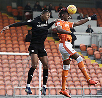 Blackpool's Armand Gnanduillet beats Barnsley's Ethan Pinnock to an aerial ball <br /> <br /> Photographer Rich Linley/CameraSport<br /> <br /> The EFL Sky Bet League One - Blackpool v Barnsley - Saturday 22nd December 2018 - Bloomfield Road - Blackpool<br /> <br /> World Copyright &copy; 2018 CameraSport. All rights reserved. 43 Linden Ave. Countesthorpe. Leicester. England. LE8 5PG - Tel: +44 (0) 116 277 4147 - admin@camerasport.com - www.camerasport.com