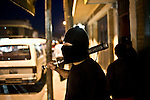 Hooded patrolmen fighting crime in Guatemala by Daniele Volpe