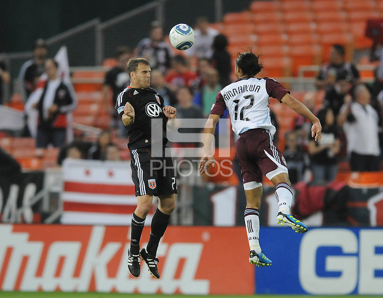 DC United defender Daniel Woolard (21) heads the ball against Colorado Rapids forward Quincy Amarikwa (12)   DC United tied The Colorado Rapids 1-1, at RFK Stadium, Saturday  May 14, 2011.
