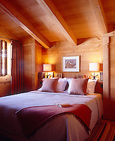 Large comfortable beds give a luxurious feel to the chalet bedrooms