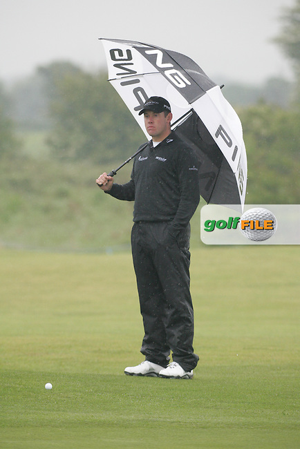 Day one from the 3 Irish open in Co Louth Golf Club..Lee Westwood waiting to play his third shot onto the 18th green..Photo: Fran Caffrey/www.golffile.ie..