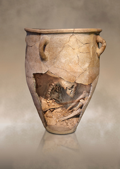 The Minoan clay burial pithos with skeleton in foetal,  Neopalatial period 1700-1450 BC; Heraklion Archaeological  Museum.<br /> <br /> The body was placed in a foetal postion to aid insertion into the wide mouthed pithos