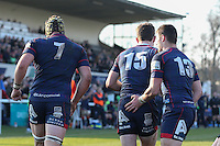 Peter Lydon of London Scottish (15) is congratulated by Danny Kenny of London Scottish (7) and Robbie Fergusson of London Scottish (13) after he scores a try during the Greene King IPA Championship match between London Scottish Football Club and Jersey at Richmond Athletic Ground, Richmond, United Kingdom on 18 February 2017. Photo by David Horn / PRiME Media Images.