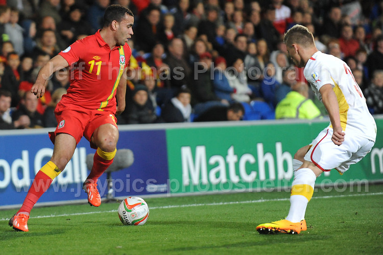 Cardiff City Stadium, Friday 11th Oct 2013. Hal Robson-Kanu of Wales battles with Ezgjan Alioski of Macedonia during the Wales v Macedonia FIFA World Cup 2014 Qualifier match at Cardiff City Stadium, Cardiff, Friday 11th Oct 2014. All images are the copyright of Jeff Thomas Photography-07837 386244-www.jaypics.photoshelter.com
