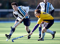 Daniel Walsh (L) in action for Hampstead during the EHL Mens Cup Quarter-Final game between Hampstead and Westminster and Old Loughtonians at the Paddington Recreation Ground, Maida Vale on Sun Mar 7, 2010