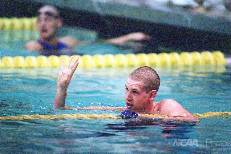 16 MAR 2002:  Ben Michaelson of Southern Connecticut State University counts his fourth victory during the national event winning the 100 yard freestyle event during the  Division 2 Men's Swimming and Diving National Championship held at the Central Florida YMCA Aquatic Center in Orlando, FL.  Michaelson won the race with a 44.24 time.  Jamie Schwaberow/NCAA Photos