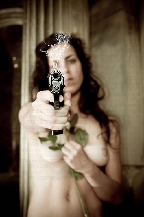 Nude woman holding a pistol