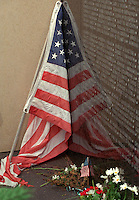 Vietnam Wall decorated with flowers and flag at Memorial Day gathering. St Paul Minnesota USA