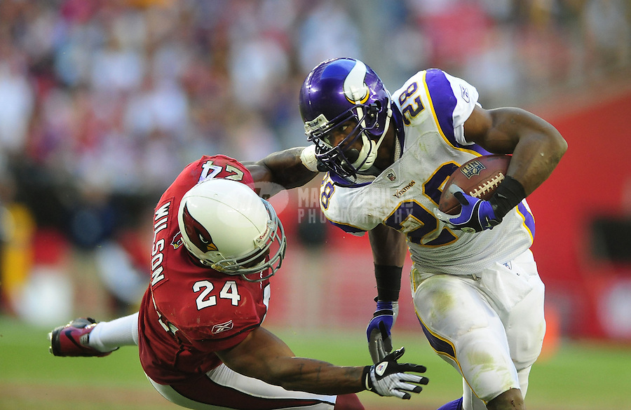 Dec. 14, 2008; Glendale, AZ, USA; Minnesota Vikings running back (28) Adrian Peterson is tackled by Arizona Cardinals safety (24) Adrian Wilson at University of Phoenix Stadium. Mandatory Credit: Mark J. Rebilas-