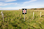 Protective sign warning against digging at an archaeological site on Salisbury Plain, Wiltshire, England, UK