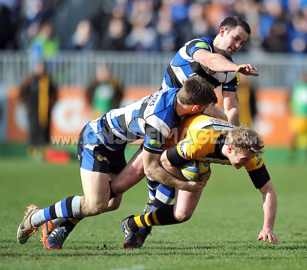 Joe Carlisle is tackled to ground by Tom Heathcote. Aviva Premiership match, between Bath Rugby and London Wasps on February 22, 2014 at the Recreation Ground in Bath, England. Photo by: Patrick Khachfe / Onside Images