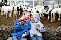 4/10/2010. Traveler boy's play with toy guns at the Ballinasloe Horse Fair, Ballinasloe, Ireland. Picture James Horan