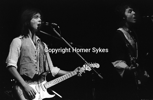 "Jimmy McCulloch Paul and Linda McCartney Wings Tour 1975. The photographs from this set were taken in 1975. I was on tour with them for a children's ""Fact Book"". This book was called, The Facts about a Pop Group Featuring Wings. Introduced by Paul McCartney, published by G.Whizzard. They had recently recorded albums, Wildlife, Red Rose Speedway, Band on the Run and Venus and Mars. I believe it was the English leg of Wings Over the World tour. But as I recall they were promoting,  Band on the Run and Venus and Mars in particular."