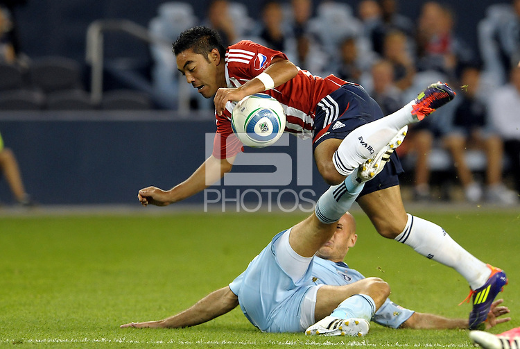 Marco Fabian (8) midfielder Chivas Guadaljara tackled by Sporting KC defender Aurelien Collin... Sporting Kansas City and Chivas Guadalajara played to a 2-2 tie in an international friendly at LIVESTRONG Sporting Park, Kansas City, Kansas.