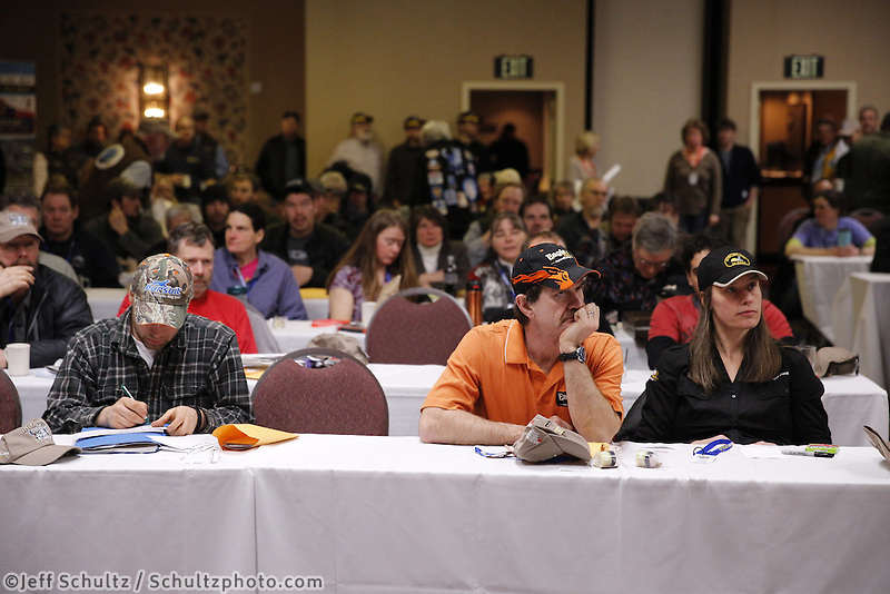 Husband and wife Allen Moore and Aliy Zirkle listen during the mandatory musher meeting at the Millenium hotel two days prior to the start of Iditarod 2013...Photo (C) Jeff Schultz/IditarodPhotos.com  Do not reproduce without permission.