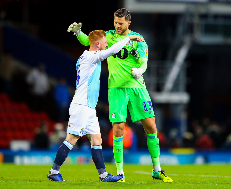Blackburn Rovers' Jayson Leutwiler celebrates after the match with Harrison Reed<br /> <br /> Photographer Alex Dodd/CameraSport<br /> <br /> The EFL Sky Bet Championship - Blackburn Rovers v Queens Park Rangers - Saturday 3rd November 2018 - Ewood Park - Blackburn<br /> <br /> World Copyright © 2018 CameraSport. All rights reserved. 43 Linden Ave. Countesthorpe. Leicester. England. LE8 5PG - Tel: +44 (0) 116 277 4147 - admin@camerasport.com - www.camerasport.com