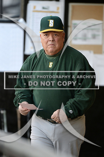 Siena Saints head coach Tony Rossi (40) in the dugout before the season opening game against the Central Florida Knights at Jay Bergman Field on February 14, 2014 in Orlando, Florida.  UCF defeated Siena 8-1.  (Copyright Mike Janes Photography)