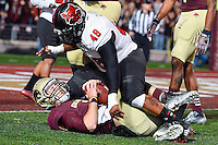 Texas State's quarterback Tyler Jones (2) is brought down short of the goal line by Arkansas State's linebacker Qushaun Lee (48) during NCAA Football game, Thursday, November 20, 2014 in San Marcos, Tex. Texas State defeated Arkansas State 45-27. (Mo Khursheed/TFV Media via AP Images)