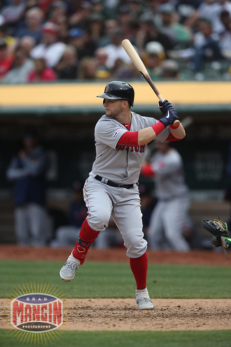 OAKLAND, CA - APRIL 4:  Andrew Benintendi #16 of the Boston Red Sox bats against the Oakland Athletics during the game at the Oakland Coliseum on Thursday, April 4, 2019 in Oakland, California. (Photo by Brad Mangin)