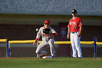 Auburn Doubledays first baseman Anthony Peroni (5) stretches for a throw as first base coach Nathan Mikolas (28) looks on during a NY-Penn League game against the Batavia Muckdogs on June 19, 2019 at Dwyer Stadium in Batavia, New York.  Auburn defeated Batavia 5-0 in the second game of a doubleheader.  (Mike Janes/Four Seam Images)